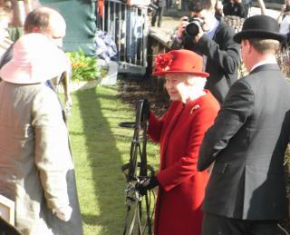 HM Queen receiving a bridle